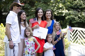 Originally from Colombia, naturalized citizen Maria Cristina Paez, center, of Ellicott City poses for a photo with loved ones after the United States Naturalization Ceremony at William Paca House and