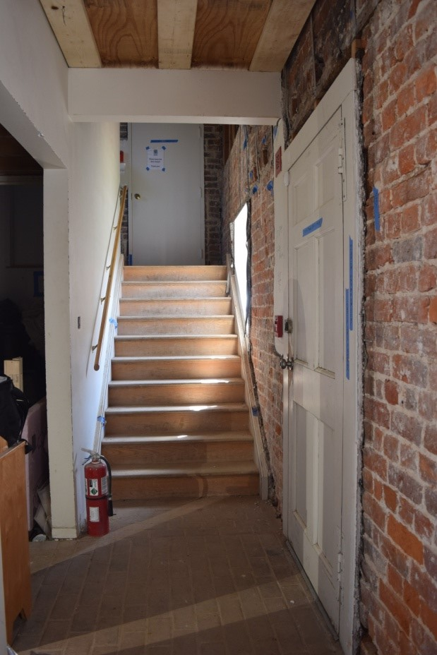 The current 20th century stair. The door at the top leads into the house.