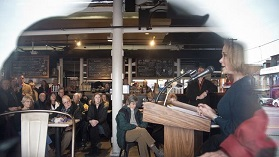 Alderwoman Elly Tierney talks about the findings of the Urban Land Institute technical assistance panel about changes to City Dock at a public meeting at the Market House in Annapolis. (Joshua McKerro